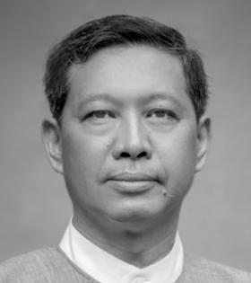 In the period of 1986-2007, he worked from the position of tutor to Associate Professor at the Department of Mathematics in Yangon University.
