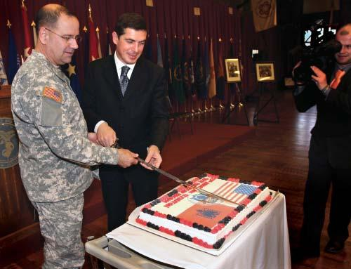 Gazmend Oketa (right), Minister of Defense, Republic of Albania cut a special anniversary cake commemorating the 15-year partnership between New Jersey and the Republic of Albania.