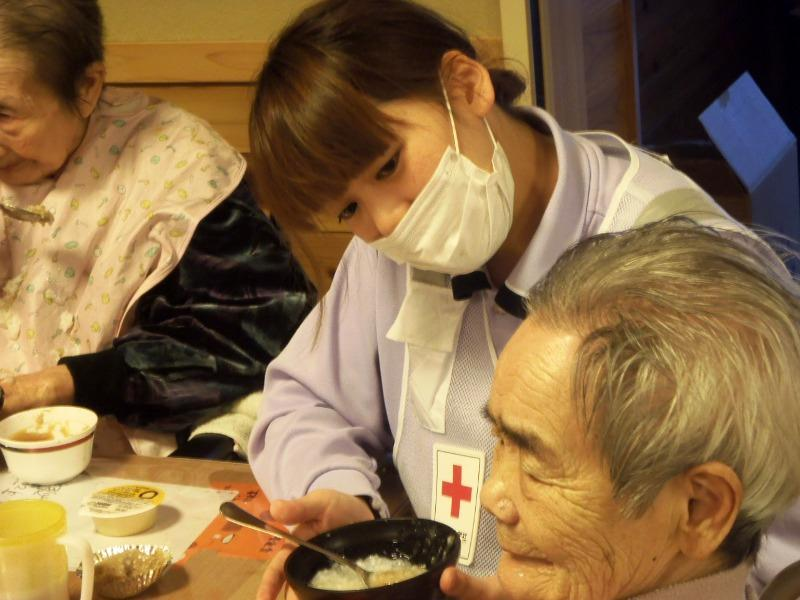 with a young tsunami survivor in an evacuation centre in Yamada, Iwate Kathy