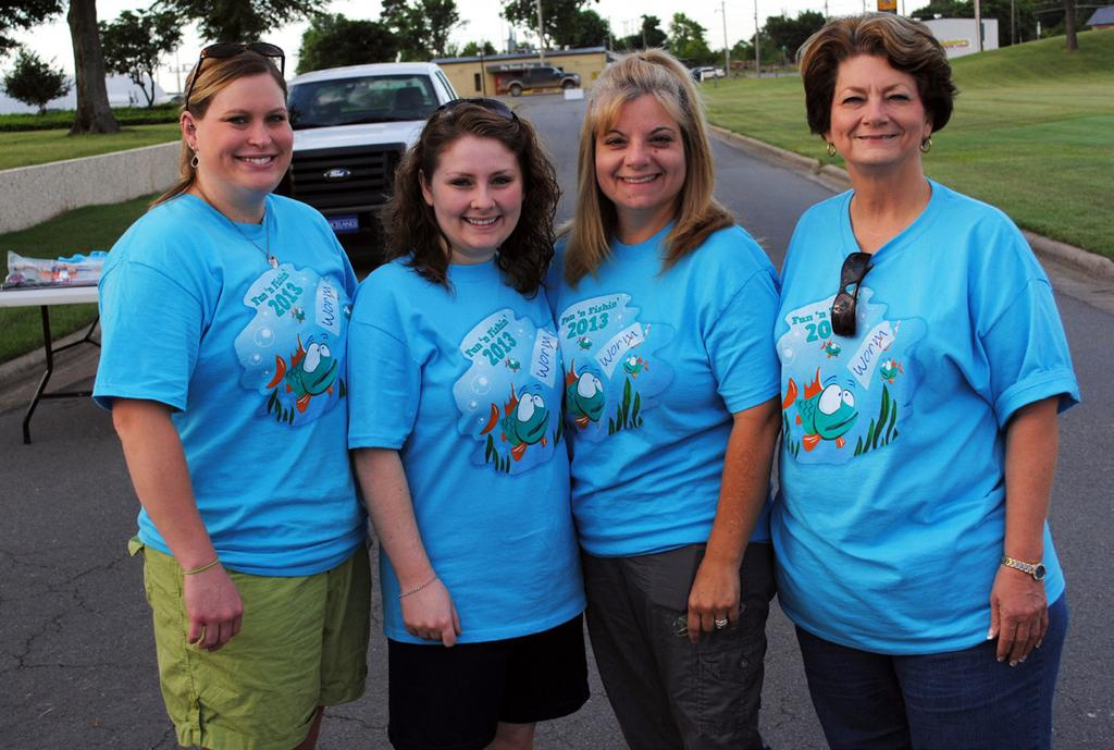 BANK VOLUNTEERS BancorpSouth volunteers at Fun N Fishin included Andrea Prislovsky, Lauren