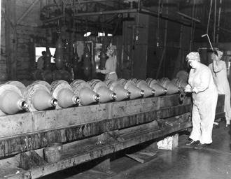 Women helped on many farms. McDonald 7-28-43-2 Several Nebraska communities were selected as sites for government defense factories.