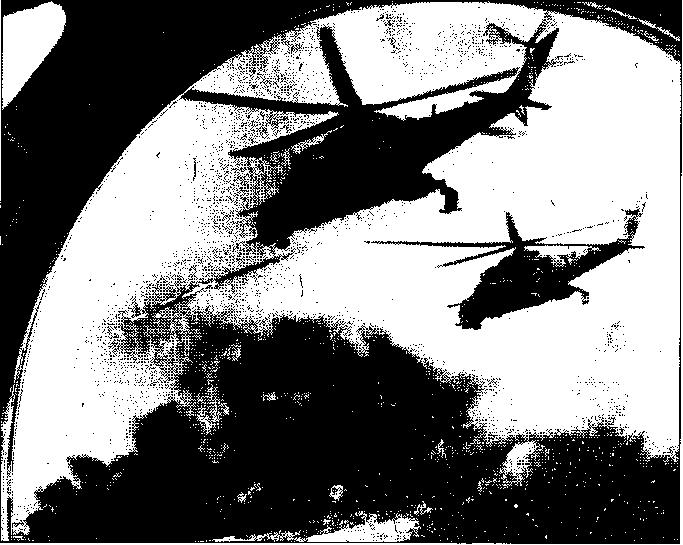 "Mi-24 ""HIND"" helicopter gunships in action in the"