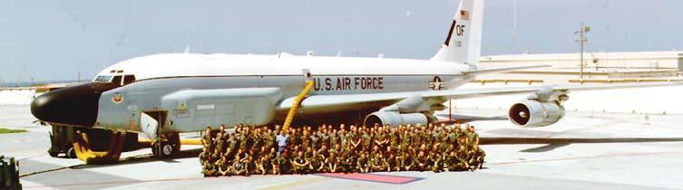 Members of AFIC s 6990 ESS, Kadena AB, Japan, pose with an RC-135 Rivet Joint Aircraft--summer 1992.