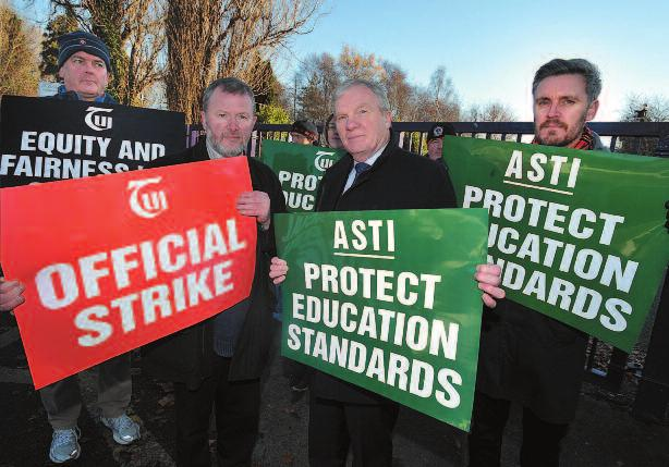 TUi AND ASTi GeNerAL SeCreTArieS JOhN MACGABhANN AND PAT KiNG ON The PiCKeT LiNe AT rosmini COMMUNiTY SChOOL in DeCeMBer.
