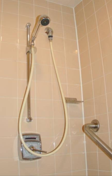 Bathrooms Bathrooms are equipped with showers and handheld shower nozzles Shower head is removable to allow specific placement of spray At