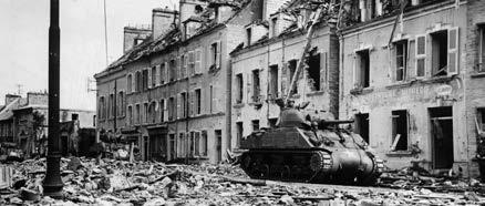 After the D-Day invasion, it was common to see tanks in the streets of towns such as Tour-La-Ville in Normandy. 8:00 AM, most of the fighting was over.