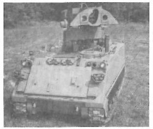 "Designed for a nine-man infantry squad, it includes a two-man turret for the commander and gunner. Armament includes the 25mm ""chain gun,"" a 7."