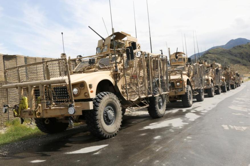 U.S. Soldiers assigned to Alpha Company, 426th Brigade Support Battalion, 1st Brigade Combat Team, 101st Airborne Division, line up their vehicles during retrograde operations at Forward Operation