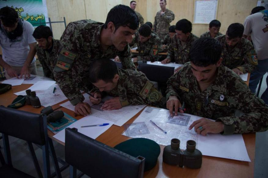Afghan National Army (ANA) soldiers plot coordinates during a call for fire training exercise at Forward Operating Base Gamberi, Laghman province, Afghanistan, May