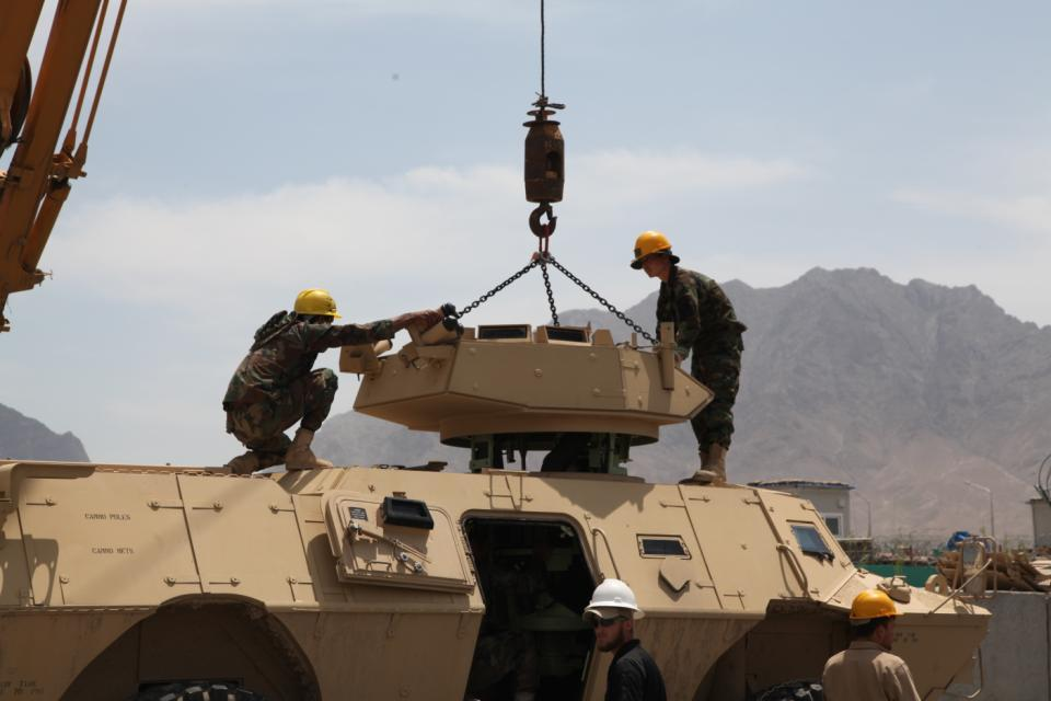 Afghan National Army (ANA) students remove the turret on a Mobile Strike Force Vehicle for maintenance on a Mobile Strike Force Vehicle at the ANA Armored Branch School in Kabul