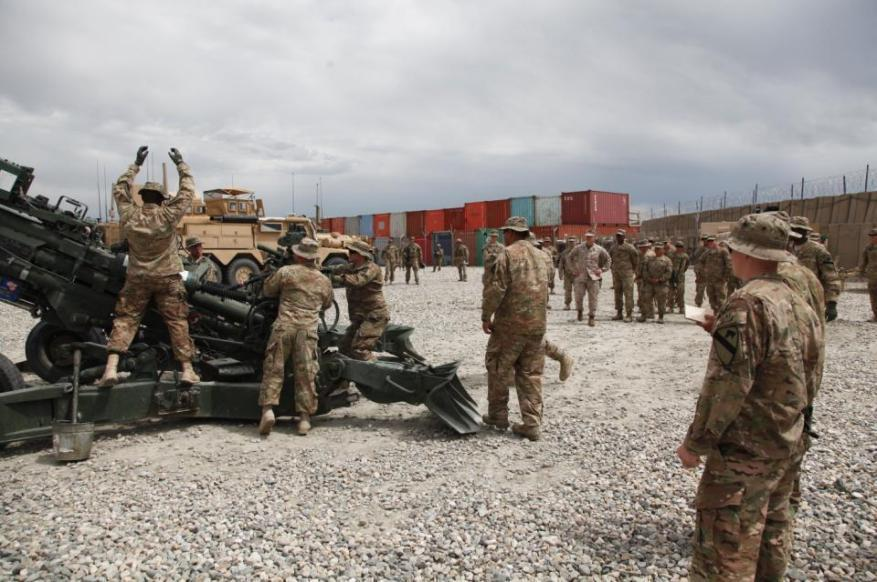 Soldiers with 3rd Platoon, Alpha Battery, 5th Battalion, 82 Field Artillery Regiment, 4th Brigade, 1st Cavalry Division, demonstrate the proper procedures used to train Afghan National Army soldiers