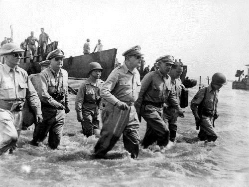 Battle of Leyte Gulf On reaching the beach, McArthur declared, People of