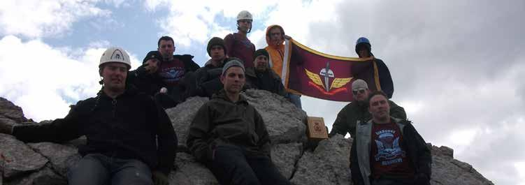 Bravo Company THIRD BATTALION Top; Summit Team One of 3 PPCLI Para Company holds their colours with pride on top of Normandy Peak.