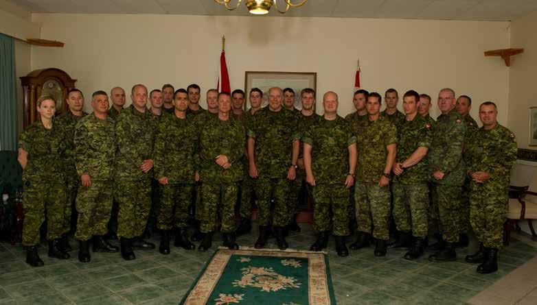 Badging Ceremony PPCLI, Lt Ethier being coined by the COTR (27 Jan 2011): Left-Right: LGen RR Crabbe, MGen DA Fraser, CWO CA White, CWO SD Stevens,