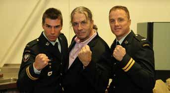 Bret The Hitman Hart with MCpl Gareth Hayter in a cross-face chicken wing. Photo: Sgt Gauthier, 1 PPCLI.