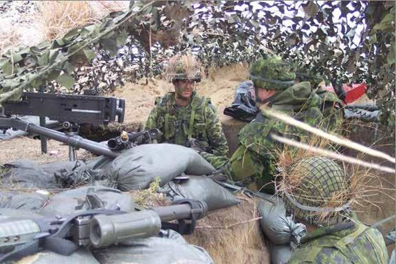 COR LGen Ray Crabbe with HCol of the Fort Gary Horse, Ray McFeetors, speaking to A Coy soldiers in the.50 cal trench.