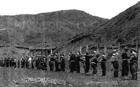 386 Chapter 6 Fig. 6.16 April 1950, 15 km north-east of Seoul. Execution of 39 civilians. They were suspected of being Communists but the exact charges brought against them are not known.