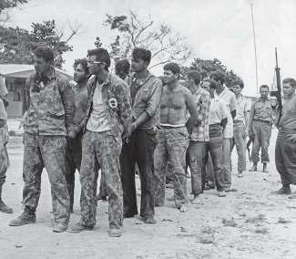 Brigade members being rounded up as prisoners of war after the battle.