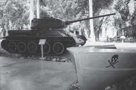 Relics from the Bay of Pigs battle exhibited at the Museum of the Revolution in Havana: a T-34/85 tank, and one of the Brigade s small landing boats.