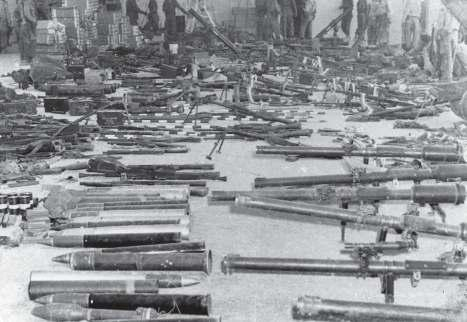 58 Some of the Brigade s arsenal of weapons and ordnance, captured after the battle, is placed on display.