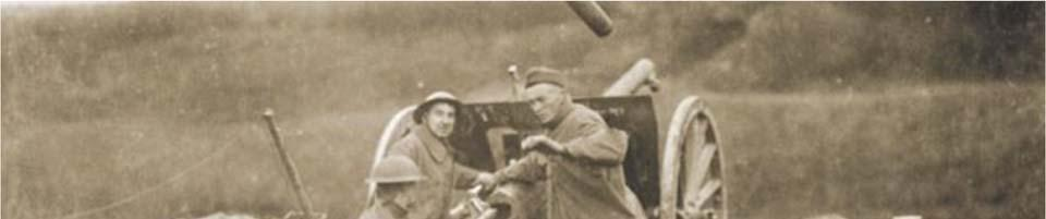 (This gun crew is operating a 75 mm gun like those used by the 317th Field Artillery.