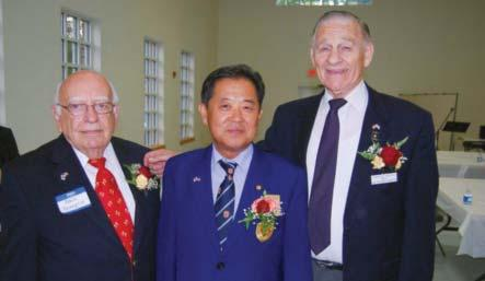 Sunny Park, Consulate Kim, Gen. (Ret.) Larry Ellis (L-R) After dinner, chapter member Robert J.