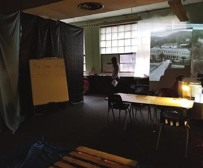 They then sat in the recreated barracks, read about a immigrant who came through Angel Island, and finished out the project by painting their translated poems on the recreated walls, simulating the