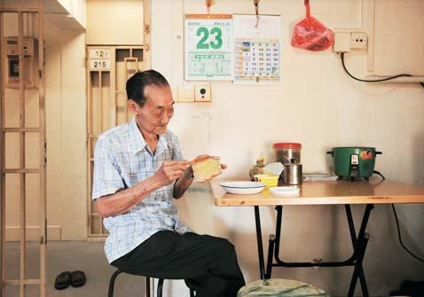 """ Toh Heok Khin, 80, has been living alone in his one-room flat in Kim Tian Place for the past 20 years."