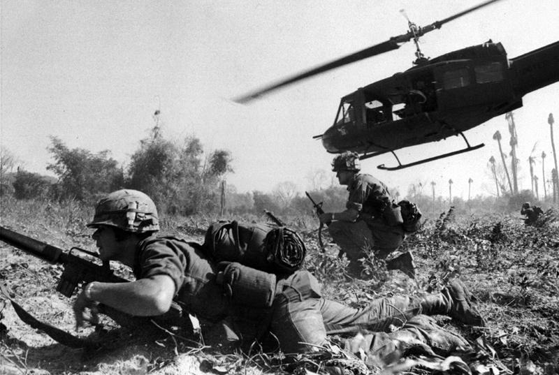 Photo courtesy of U.S. Army MAJ Bruce Crandall s UH-1D helicopter climbs skyward after discharging a load of Infantrymen on a search and destroy mission. grenade launchers to fire against the probes.