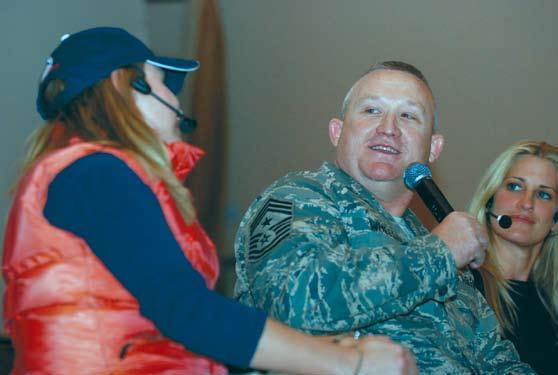 Paul Wheeler, the 332nd Air Expeditionary Wing command chief master sergeant, participates in a skit during the USO Laugh in the New Year