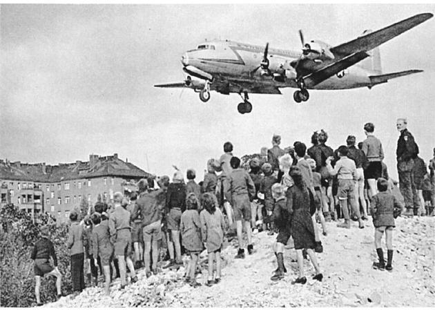 Dividing Germany U.S., Britain, and France merged their zones in 1948 to create an independent West German state. The Soviets responded by blockading land access to Berlin. The U.S. began a massive airlift of supplies that lasted almost a year.