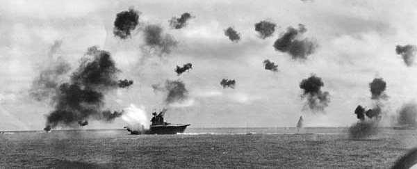 Beyond the horizon, the Japanese began their assault on the Island. As the Japanese planes got Into the air, the American planes swooped in to attack the Japanese fleet.
