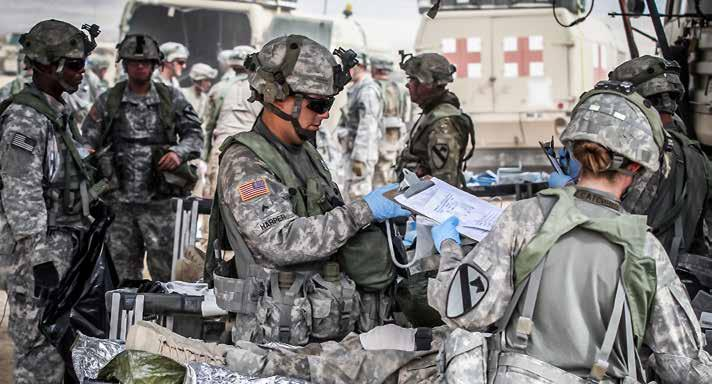 Medics treat simulated casualties at the 115th Brigade Support Battalion s aid station during a mass casualty exercise at the National Training Center, on Oct. 14, 2015. (Photo by Staff Sgt.