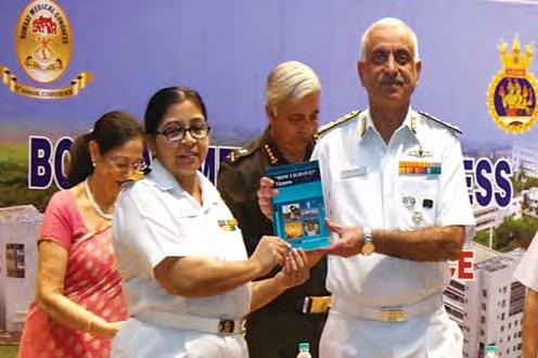 Books titled How I Survive by Surgeon Commander Vidhu Bhatnagar and a Handbook of