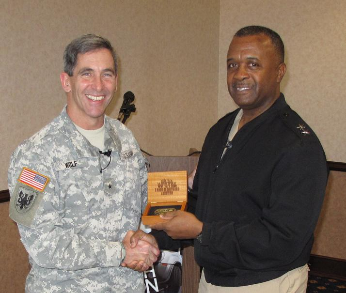 Wolf, director of Army Safety Director, Richard Wright, United States Army Corps of Engineers, with a coin and certificate of appreciation.