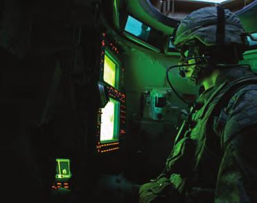 Tank Commander SGT David Newland monitors his workstation in his M1A2 Abrams tank. AMC completed an FMI pilot at the U.S. Army Armor School at Fort Knox.