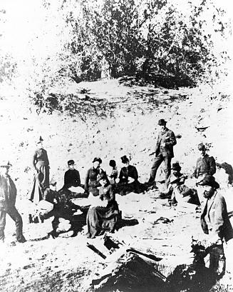 Officers and wives on a picnic near Ft. Apache, Arizona, on 30 December 1883. Left to right: (Standing) 1st Lt. Charles B.
