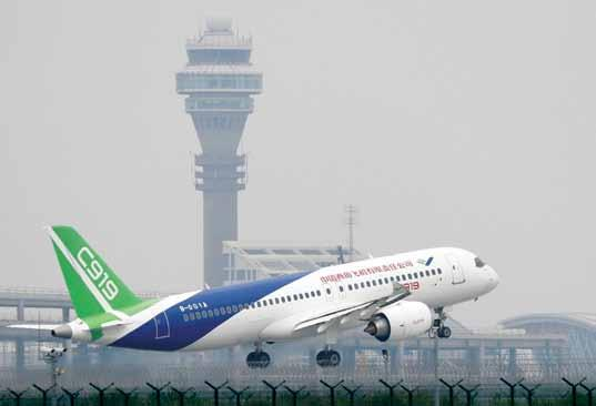 China s Civil Challenge C919 passenger jet taking off at Pudong International Airport in Shanghai The Comac C919 is airborne China s first indigenous designed and built passenger jetliner the C919