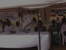 Above: The Federation Head of Sub-Regional Office, the Nigerian Red Cross President and PLWHA Coordinator at ceremonies celebrating World Red Cross and Red Crescent Day 2004 Rally at Refugees Camp in