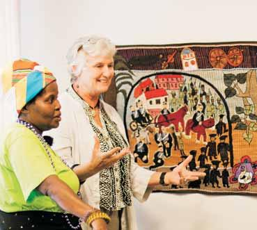 Rhodes University Fine Art Biotech Students with Professor Another Person Noseti Makubalo and Dr Carol Hofmeyr of the Keiskamma Art Project speaking about the Rhodes University Tapestry at the formal