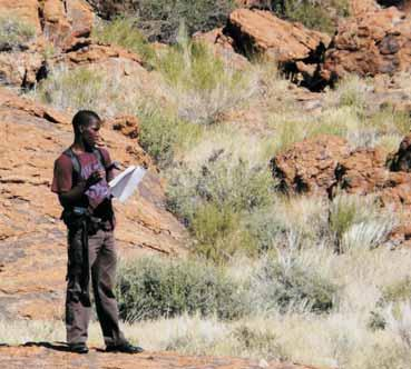 Rhodes University Geology Honours student mapping shear stones in the Northern Cape.