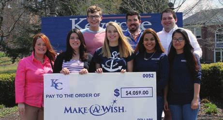 Gathering during a check presentation, front from left: Maggie O Brien, Make-A-Wish, regional manager; Luci McConkey 07, director of student activities; and Maggie Emmons 14, Yauris Romero, and Hoa