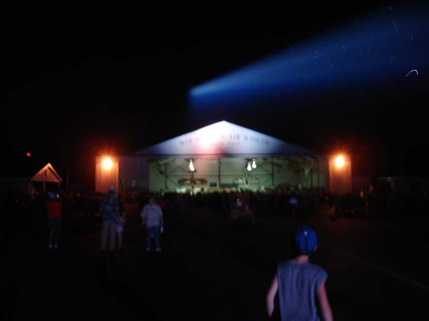 While event attendees danced, the searchlight put a beam over the hanger.