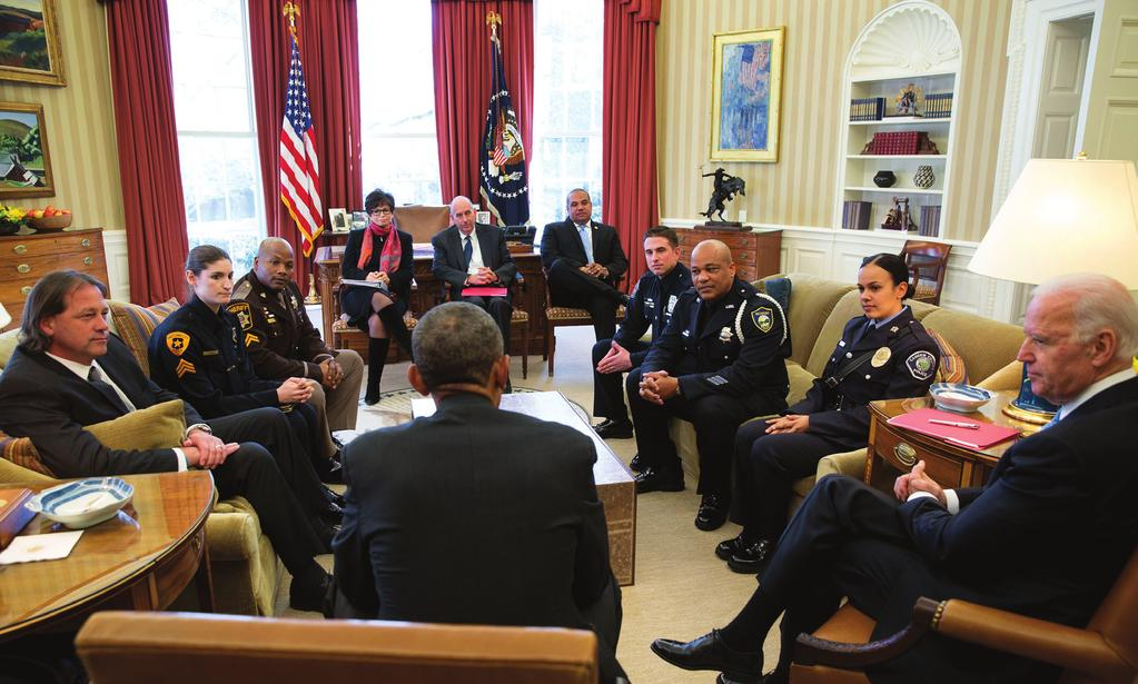 President Obama, Vice President Joe Biden, and Administration officials meet with rank-and-file law enforcement officers from across the country in the Oval Office on February 24, 2015.