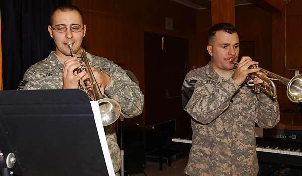 BAGHDAD Specialists Phil Terrell and David Sturch, trumpet players in the 1st Cavalry Division s rock band, perform in a holiday concert, Dec.