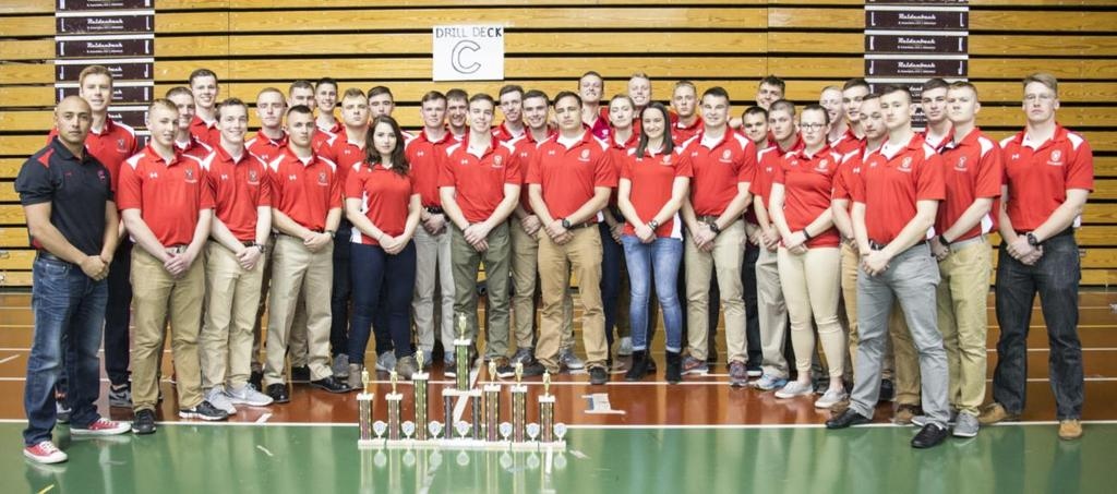 Badgers Excel at Villanova s Drill Meet MIDN 3/C Jackson Lanigan Photos by MIDN 4/C Zachary Schramm Above: The Badger team poses with their hard-earned trophies.