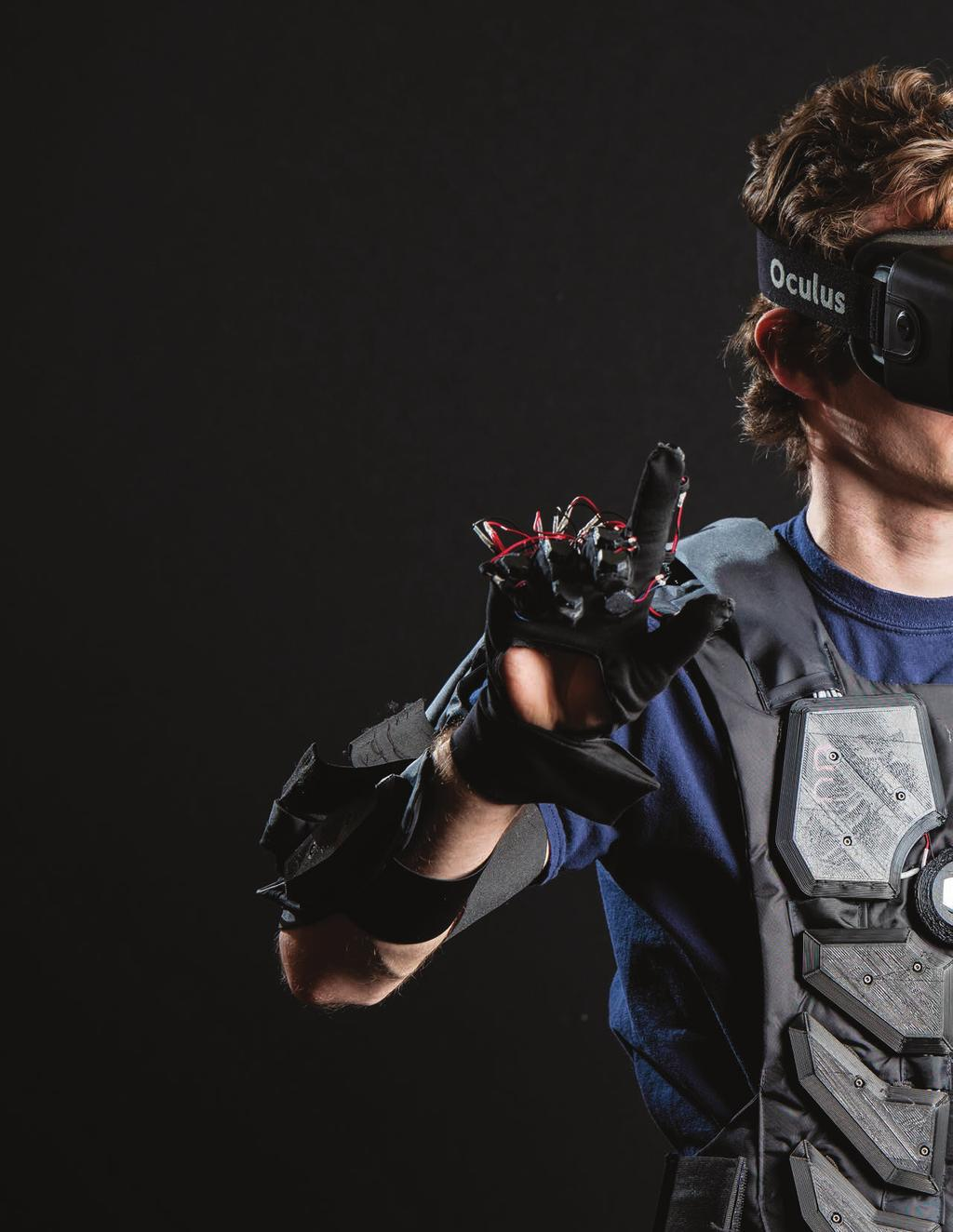 In Review STUDENT ENTREPRENEURS Vision of Virtual Reality BODY BY DESIGN: Lucian Copeland 16, an electrical and computer engineering major from Northfield, Massachusetts, models a prototype of a