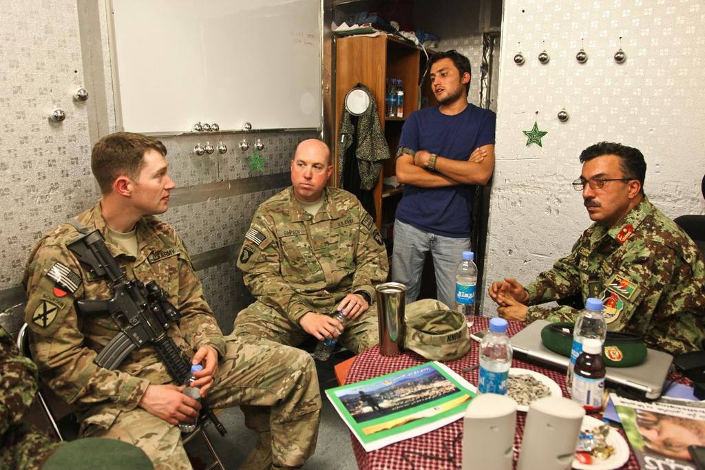 Meeting at FOB Gamberi U.S. Army Capt. David Dunn, public affairs officer, left, Maj.