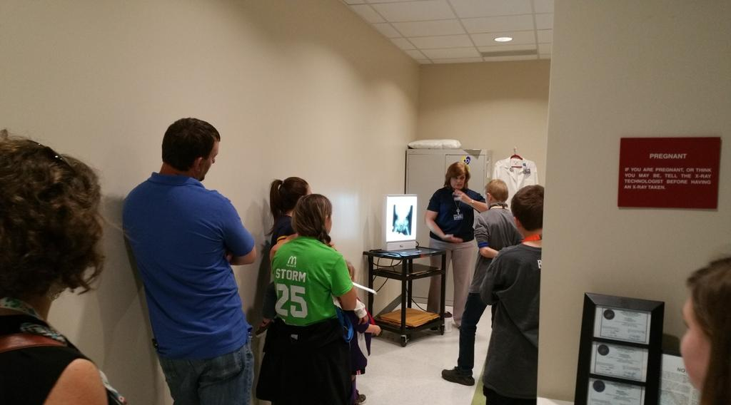 Kids and parents lined up to learn about the field of radiology and the real-world equipment utilized when teaching radiology students how to conduct x-rays on