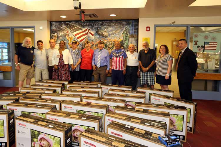 Westhoven/Released) Members of the Cairola-Barber Post 2342, Fort Lee Veterans of Foreign Wars, donate 30 flat screen televisions to the New Jersey Veterans Memorial Home